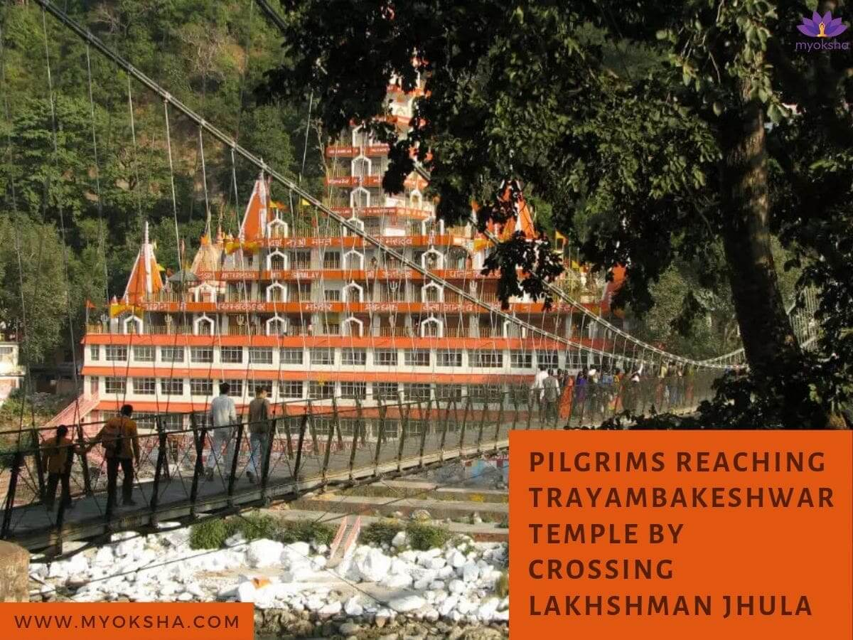 People walking on Laxman Jhula to reach the temple